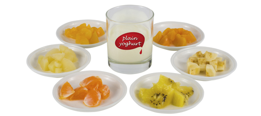 Glass Of Plain Yoghurt Surrounded By Plates Chopped Soft Fruit