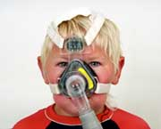 Child with CPAP mask