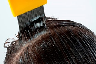 Using a fine tooth head lice comb