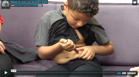 Thumbnail image of a video still showing a boy using an insulin pen.
