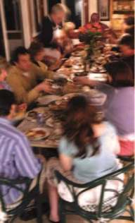 Photo of large group eating around a table