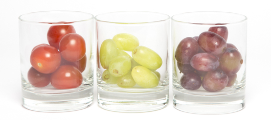Small round tomatoes, green grapes, red grapes