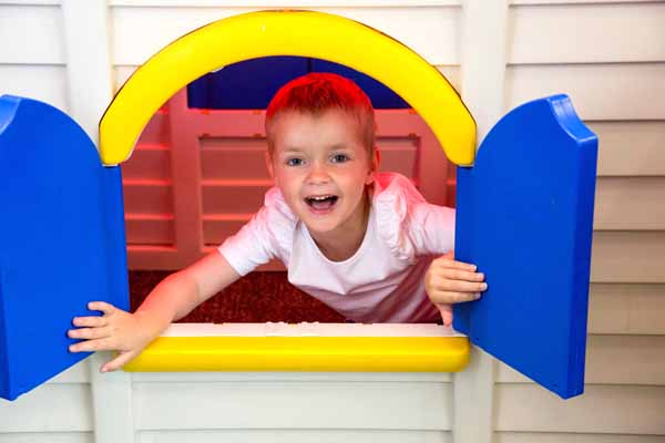 A boy in a playhouse