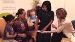 Video thumbnail image showing family ina  consultation with a doctor
