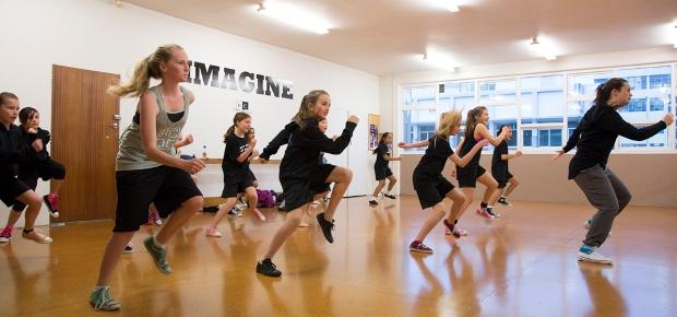 Photo of a group of teenagers in action at a dance class