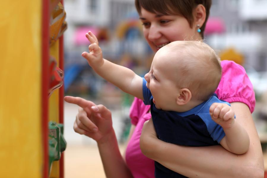 Baby and mother playing with wooden blocks