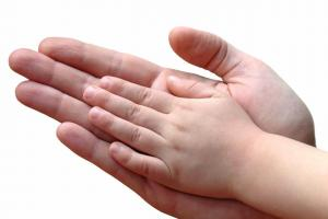 Child and parent hands together