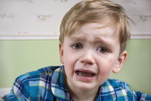 Young boy crying before bedtime