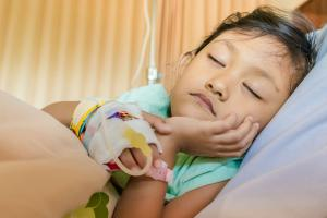 A young child in a hospital bed having treatment